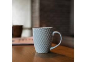 桌子柜台上咖啡杯的正视图_12065481