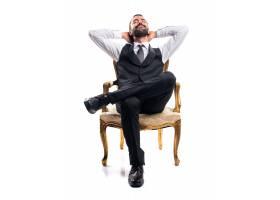 坐在扶手椅上的商人_1205162