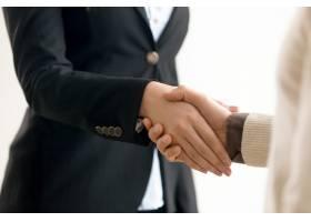 商人和女商人握手商业握手近距离观察_3938501