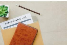 俯瞰商务办公桌背景商务贷款评估在木桌背_1276209