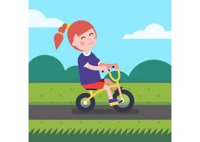 小女孩在公园的自行车道上骑自行车_1311399