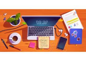 工作空间的俯视图配有笔记本电脑文具_9886785
