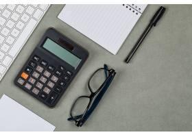 财务概念用笔记本纸笔计算器键盘_9177751