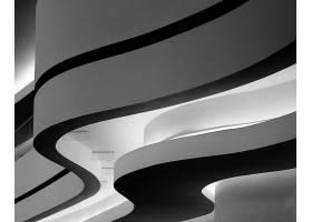 德国柏林一栋曲折建筑的特写灰度照片_10291719