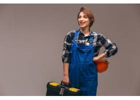 穿着制服拿着工具箱的女修理工_4410825