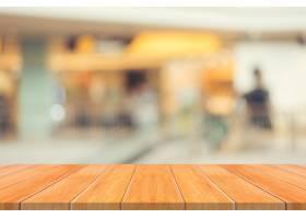 木板空桌模糊了背景在百货商店里透视棕_1381343