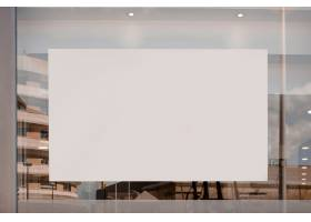 玻璃上的空白白色广告牌_3623011