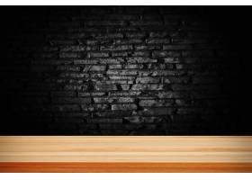 抽象的黑色垃圾砖和木制桌子甲板_1289991