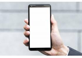 一位商人的手在模糊的背景下显示智能手机_3735202