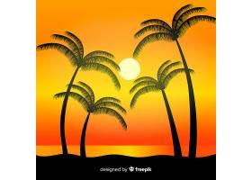 海滩的日落棕榈树的剪影_4487318