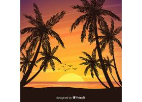 海滩的日落棕榈树的剪影_4551113