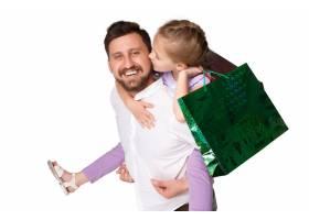 快乐的父女提着购物袋_8098524