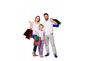 带着购物袋的幸福家庭_8098475