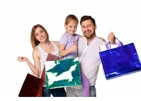 带着购物袋的幸福家庭_8098510