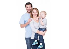 站着小婴儿的幸福家庭的肖像_11554645