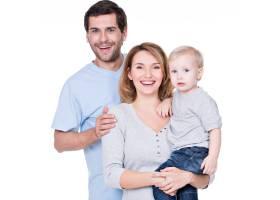 站着小婴儿的幸福家庭的肖像_11554648