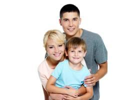 幸福的年轻家庭有6岁的儿子_10012621