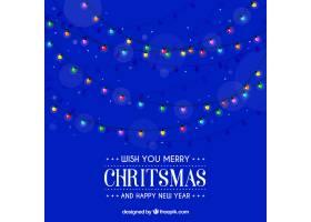 蓝色背景上的圣诞彩灯_1385970