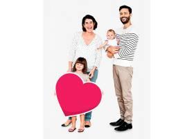 幸福的家庭抱着赫拉特形状的图标_3533868