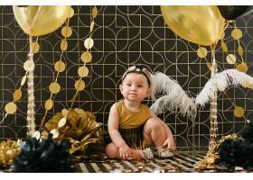 用黑色和金色气球装饰的女婴生日派对_3337151