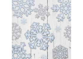 白色木质背景上的雪花_10766849