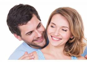 隔离的迷人微笑夫妇的特写肖像_11554682