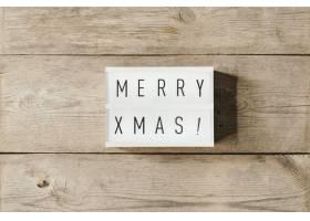 在led面板和木质背景上显示圣诞快乐文字_10765775