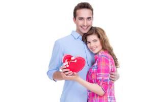 一对幸福的年轻夫妇在与世隔绝的白色背景下_11554706
