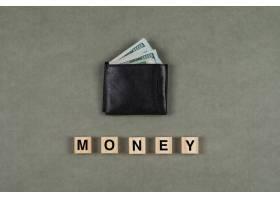 商业和金融理念与钱包里的钱一样灰色的表_8859444