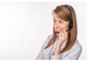 欢快的微笑支持电话女话务员在关机时戴着耳_1162622