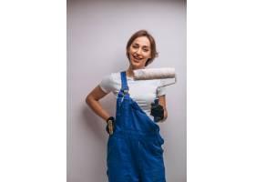 女修理工与油漆滚筒隔离_4410604