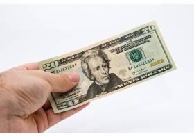 一个人拿着一张美元钞票的特写镜头_10292055