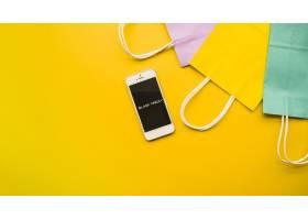 桌子上有黑色星期五铭文的手机_3270201