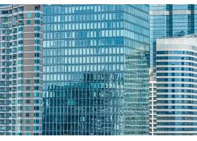 带玻璃窗背景的商务建筑外墙_9353558