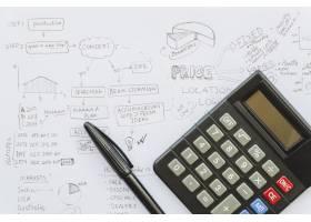 商业计划纸上带笔的计算器_3464641
