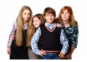 一群可爱快乐的孩子在白色背景上摆姿势_6286032