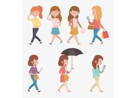 一群使用智能手机走路的美女_4938946