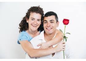 快乐的女士抱着鲜花微笑的家伙_3544874