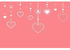 粉色背景上悬挂的心形_12458496