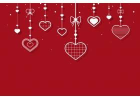 挂在红色背景上的心_12458511