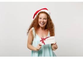 轻的衣裳的笑的年轻红头发人圣诞老人女孩_16082375