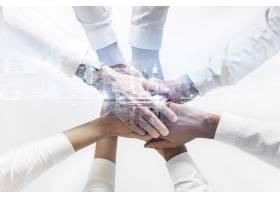 连接手的企业队在一起的手城市背景_15601195