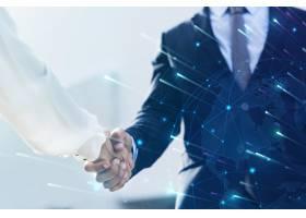 合作伙伴之间的企业业务握手_15556674
