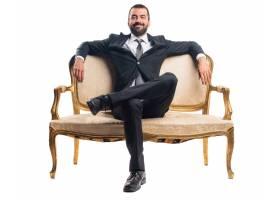 坐在扶手椅子的商人_1204022