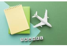 与白色飞机和笔记本的旅行概念_14308181