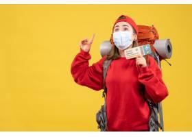 与背包和面具的前视图年轻女性旅客拿着旅行_14430583