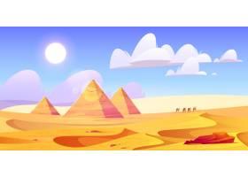 埃及沙漠景观与金字塔和骆驼大篷车_12900174