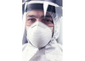 关闭在covid19期间的病毒科学家佩带的ppe设_16780418