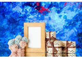 前视图空白的照片框架假日礼物在蓝色抽象背_17231553