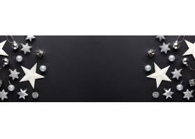 银色圣诞节装饰在黑色的中看不中用的物品_3238932